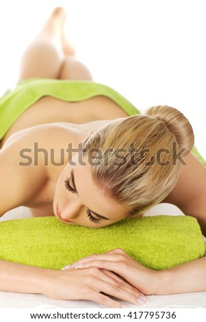 Young relaxed woman in spa. - stock photo