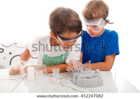 Young researchers making experiments in a white background studio