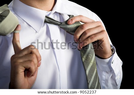 young resting businessman. taking of the necktie