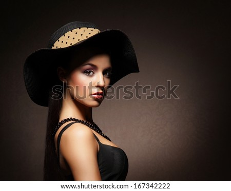 Young, rich and beautiful woman over the vintage background
