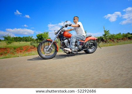 Young rider on a chopper - stock photo