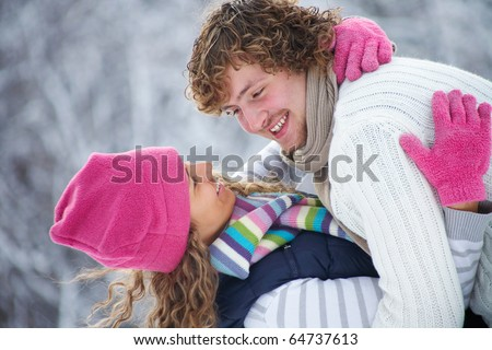 young romance couple wants to kiss in Winter Park
