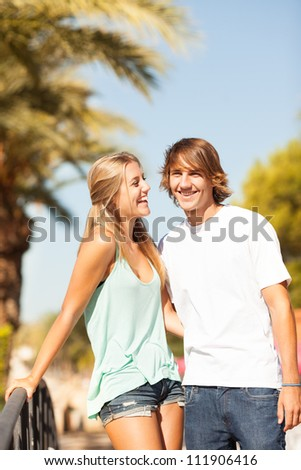 Young romantic beautiful couple enjoying on a walkside with threes