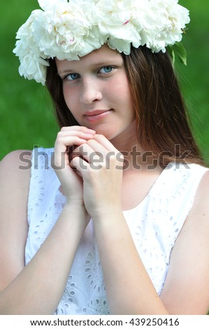 Young, romantic, beautiful girl with flowers in white dress. - stock photo