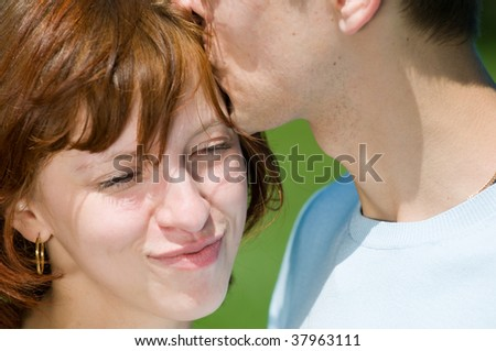 Young romantic couple in a green park