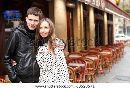 Young romantic couple in Paris, near a street cafe - stock photo