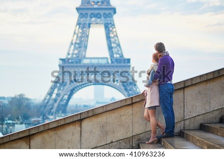 Young romantic couple near the Eiffel tower in Paris, France