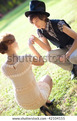 Young romantic couple outdoors. Soft colors. - stock photo