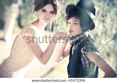 Young romantic couple portrait. Soft colors. - stock photo