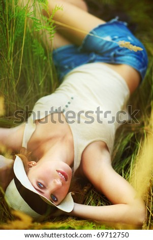 Young romantic woman outdoors portrait.