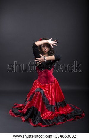 Young romany woman dance in spanish traditional clothes