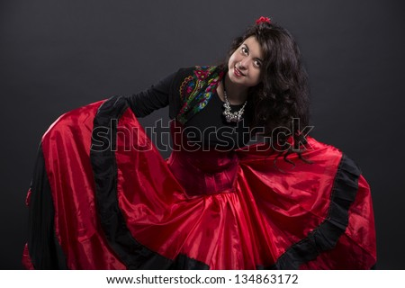 Young romany woman smiling in spanish traditional clothes