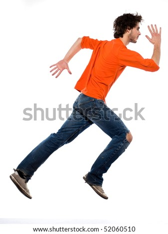 young running caucasian man portrait in studio on white background - stock photo