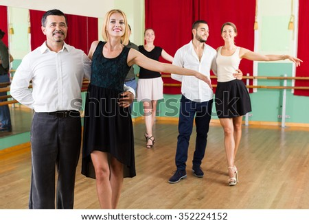 young russian group of people have fun while dancing waltz - stock photo