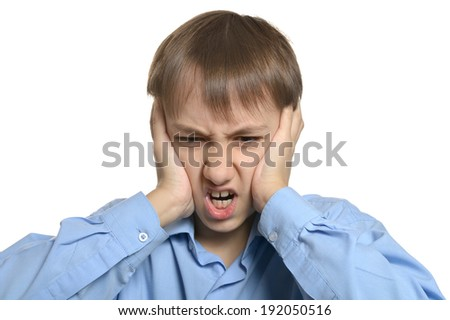 Young sad boy standing isolated on white background