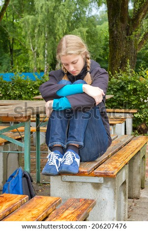 Young, sad woman - stock photo