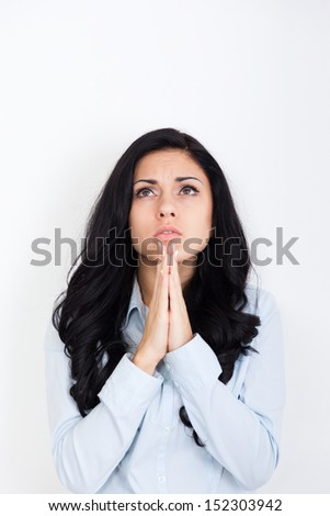 young sad woman praying holding clasp hands together, concept of girl problem, stress, depresion, negative emotion - stock photo