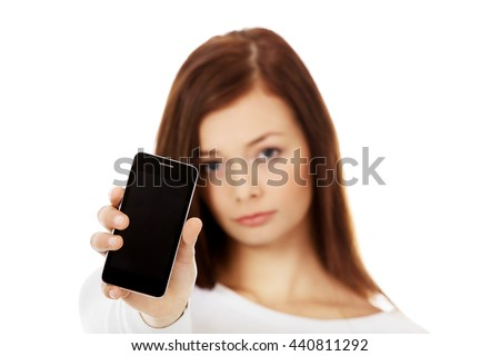 Young sad women showing broken touch screen mobile phone - stock photo