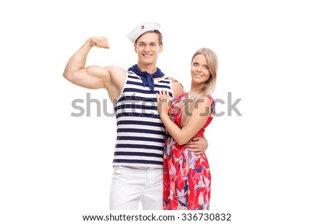 Young sailor flexing his bicep and posing together with his girlfriend isolated on white background - stock photo