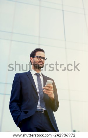 Young satisfied business man with good results of last project - stock photo