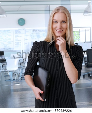 Young scandinavian businesswoman at corporate office, smiling. - stock photo