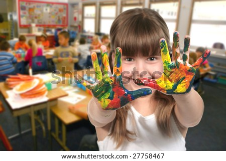 Young School Age Child Painting With Her Hands in Class - stock photo