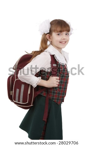 Young school girl ready for school. Little pupil is going to school. Happy young schoolgirl with satchel white background. Portrait of smiling, little girl in school uniform with backpack. - stock photo