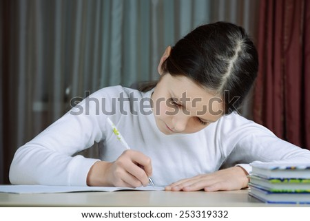 young schoolboy does his homework - stock photo