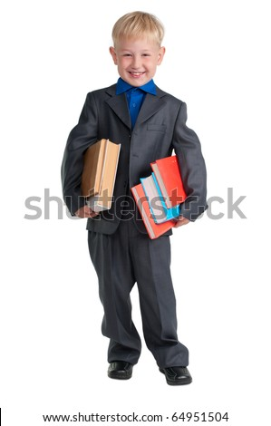 Young schoolboy holding heavy books under his arms - stock photo