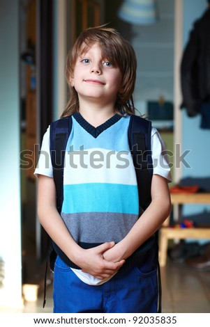 Young schoolboy with his backpack ready to go to school