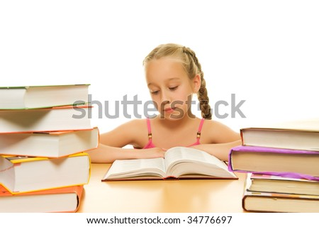 Young schoolgirl reading a book - stock photo