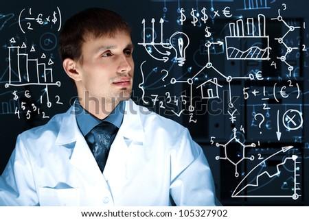 Young scientist in laboratory in white uniform - stock photo