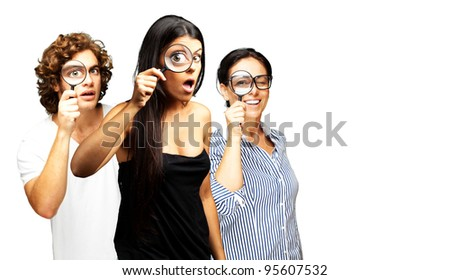 young scientist looking through a magnifying glass over white background - stock photo