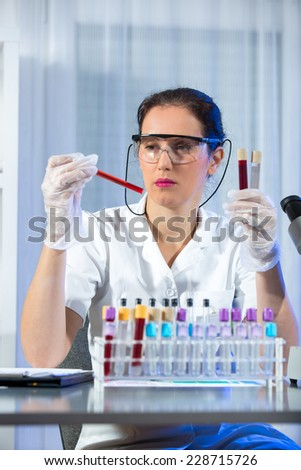 Young scientist woman working at the laboratory - stock photo