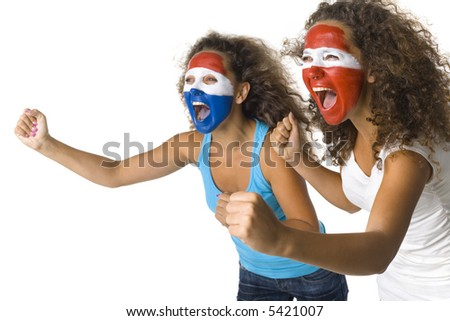 Young, screaming Austrian and  Dutch or Paraguayan sport's fans with painted flags on faces and with clenched fists. Side view, white background - stock photo
