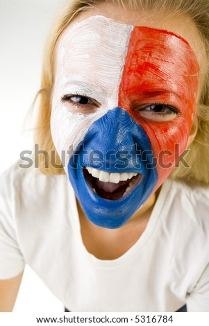 Young screaming Czechish sport's fan with painted flag on face. Front view. She's looking at camera. Closeup on face. - stock photo