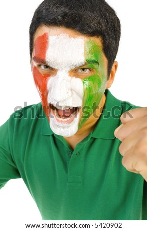 Young screaming Italian sport's fan with painted flag on face and with clenched fist. Front view. Looking at camera, white background - stock photo