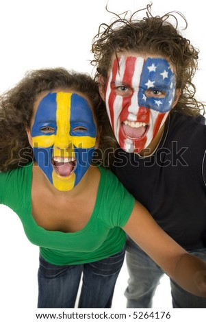 Young screaming Swedish and American fans with painted flags on faces.  They're looking at camera. - stock photo