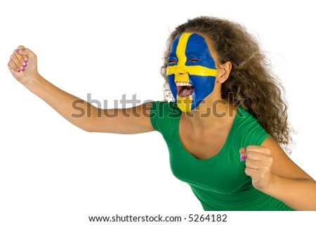 Young screaming Swedish fan with painted flag on faces. She's on white background. - stock photo