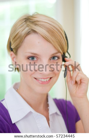 Young secretary with a headset - stock photo