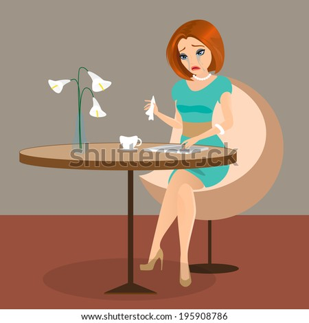 Young sensual pretty woman is crying in the cafe using a tablet pc.  - stock photo