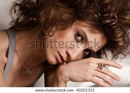 young sensual woman portrait, indoor shot - stock photo