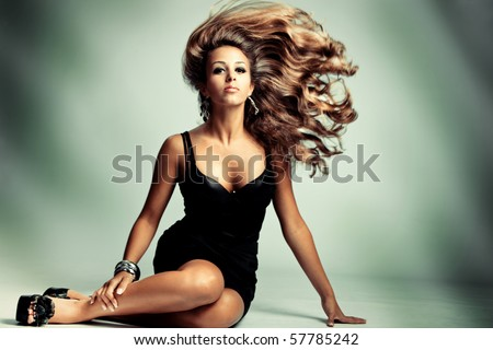 young sensual woman with long flying hair, studio shot - stock photo