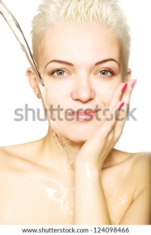 Young sensuality beautiful woman with clean skin with splash of water - white  background - stock photo