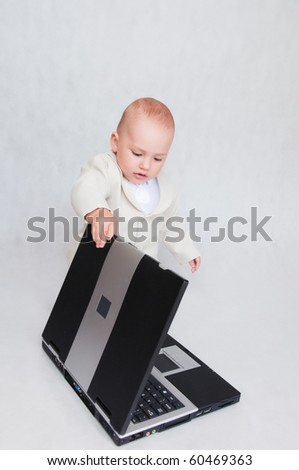 Young Serios Boy In suit with laptop