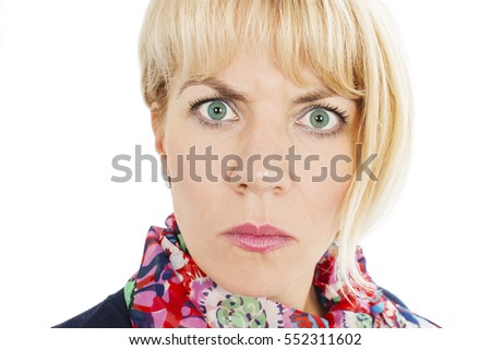 Young serious angry woman portrait. Isolated on white background. Negative human emotions facial expression