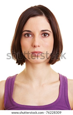 Young serious attractive woman looking into the camera - stock photo