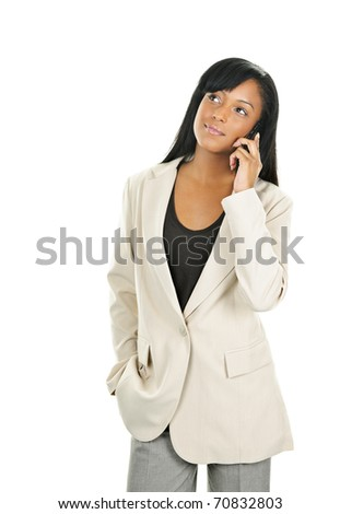 Young serious black businesswoman on cell phone looking up