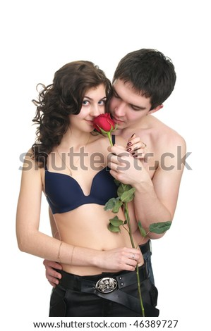 Young sexual couple with red rose isolated over white background - stock photo