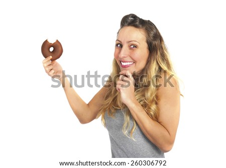 young sexy and naughty blond woman eating chocolate donut feeling happy and guilty for unhealthy nutrition and off diet calories in fitness body care concept isolated white background - stock photo